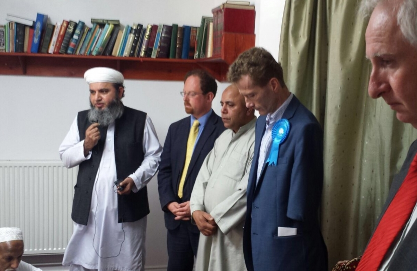 Observing a minute's silence at Cambridge mosque