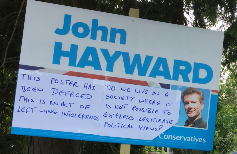 Defaced campaign poster